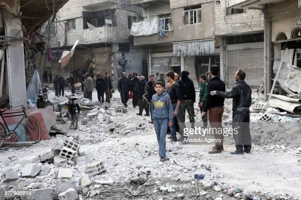 People inspect the rubble after Assad regime's warplane carried out airstrikes over Arbin town of the Eastern Ghouta region in Damascus Syria on...