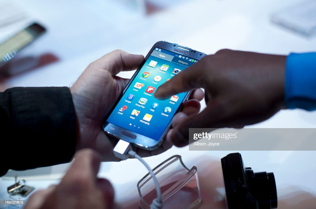 People interact with the Samsung Galaxy S IV, March 14, 2013 in New York City. Samsung, the world's largest handset maker, revealed their successor to the Galaxy S III. The Galaxy S IV features a five-inch 1080p screen, a 1.9GHz quad-core processor, a 13-megapixel rear camera and ships with the latest Android version, Jelly Bean.