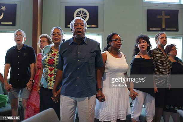 People join gather to pray during the Unity Church of Charleston interfaith prayer service for the victims of the Emanuel African Methodist Episcopal...