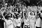 People join hands at the 'Hands Across America' benefit event helping to raise money for local charities New York City USA 25th May 1986