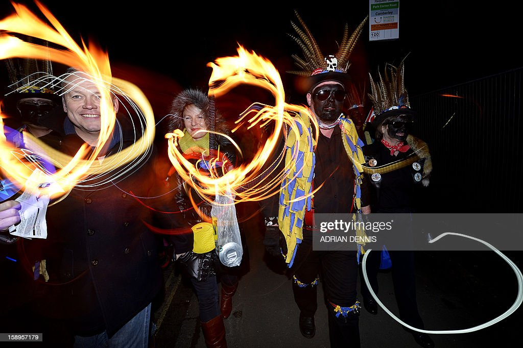 People join the dance with the Hook Eagle Morris Men outside the Waggon and Horses pub during the annual Wassail night in Hartley Wintney, 40 miles (64 Kilometers) west of London, on January 4, 2013. The event, held near to twelfth night, celebrates both the passing of Christmas and the future good health of the fruit trees. Traditionally the custom involved the local farm workers visiting the orchard after dark with shotguns, horns, food and a large pail of cider. They would make a loud noise to raise the Sleeping Tree Spirit and to scare off demons. Cider would be poured over the roots and pieces of toast placed in the branches as a gift to the spirit of the tree. The wassail song is sung as a blessing or charm to bring fruitfulness or even in admonishment not to fail in the upcoming year.