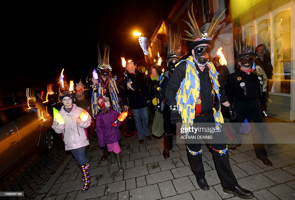 People join the Hook Eagle Morris Men outside the Waggon and Horses pub during the annual Wassail night in Hartley Wintney, 40 miles (64 Kilometers) west of London, on January 4, 2013. The event, held near to twelfth night, celebrates both the passing of Christmas and the future good health of the fruit trees. Traditionally the custom involved the local farm workers visiting the orchard after dark with shotguns, horns, food and a large pail of cider. They would make a loud noise to raise the Sleeping Tree Spirit and to scare off demons. Cider would be poured over the roots and pieces of toast placed in the branches as a gift to the spirit of the tree. The wassail song is sung as a blessing or charm to bring fruitfulness or even in admonishment not to fail in the upcoming year.