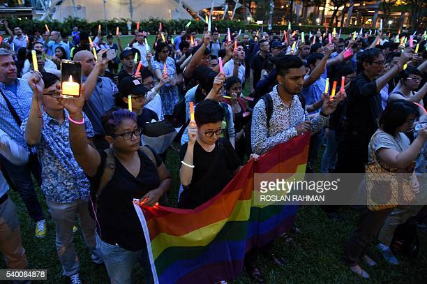 People join the LGBT community as they raise light sticks in Hong Lim park during a vigil for the victims of the Orlando shooting in Florida in...