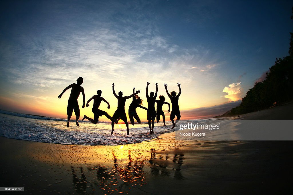 People jumping on beach at sunset in Costa Rica : Stock Photo