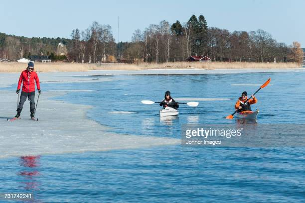 People kayaking and skiing