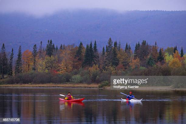 People kayaking in the fall on Lake LacMonroe MontTremblant National Park in the Laurentians in Quebec Province Canada