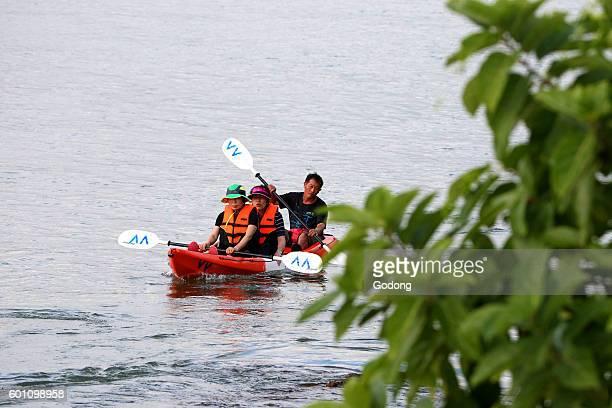 People kayaking on the Nam Song river Vang Vieng Laos