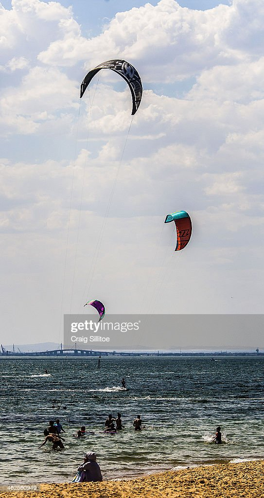 People kite surf at Brighton Beach on January 14, 2014 in Melbourne, Australia. Temperatures are expected to reach over 40 degrees Celsius in parts of Victoria over the next four days.