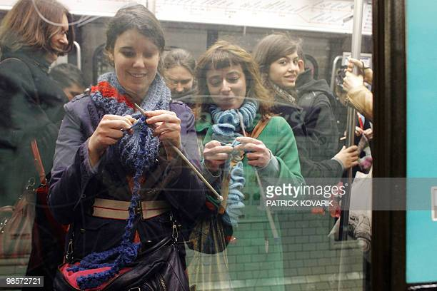 People knit in a subway station in Paris on April 14 during a flash mob event organized by a group of young knitting people AFP PHOTO / PATRICK...