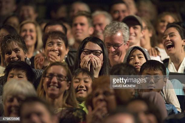 People laugh at humorous statements by the Dalai Lama at the University of CaliforniaIrvine on July 7 in Irvine California where the Tibetan Buddhist...