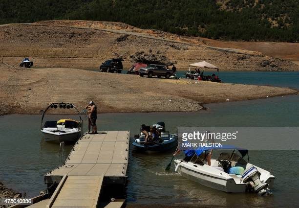 People launch their boats near an almost dry section of the Shasta Lake reservoir which is now at less than 20 percent capacity as a severe drought...
