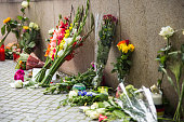People lay flowers and candles outside the OEZ shopping center the day after a shooting spree left nine victims dead on July 23 2016 in Munich...