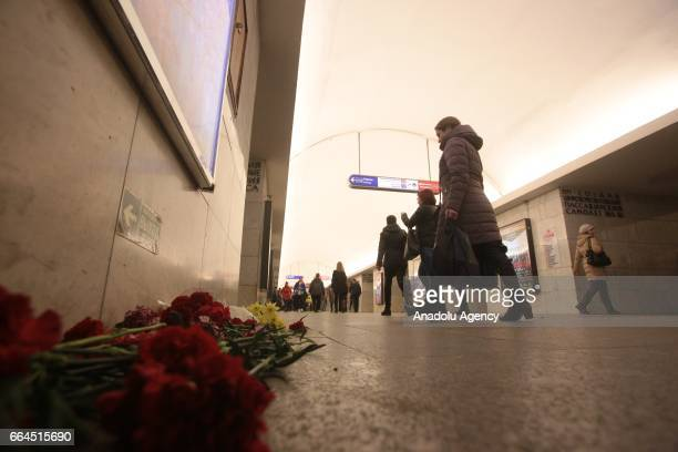 People lay flowers at a Tekhnologichesky institute subway station in St Petersburg Russia on April 4 2017 A blast hit a train carriage between...