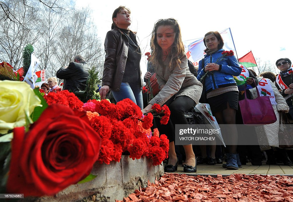 People lay flowers at the Chernobyl victims' memorial in the Belarus capital Minsk on April 26, 2013. The world marked today the 27th anniversary of the world's worst nuclear disaster at Chernobyl nuclear pant in Ukraine.