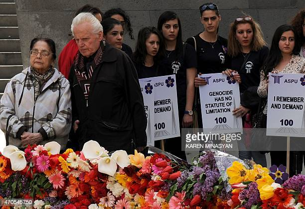 People lay flowers at the Tsitsernakaberd Armenian Genocide Memorial in Yerevan on April 212015 Armenians prepare to commemorate on April 24 a...