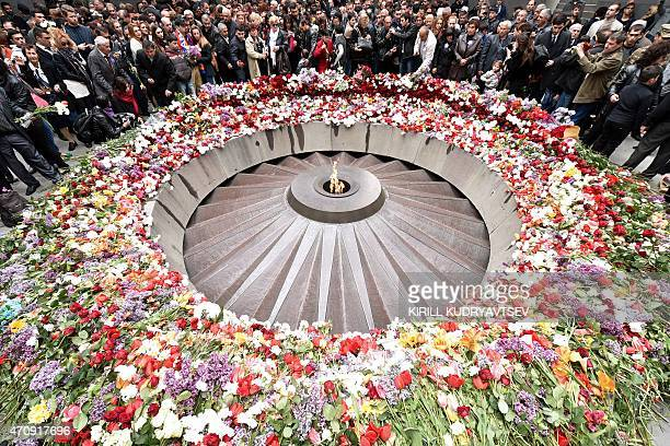 People lay flowers at the Tsitsernakaberd Memorial on April 24 2015 in Yerevan as part of the Armenian genocide centenary commemoration Armenians on...