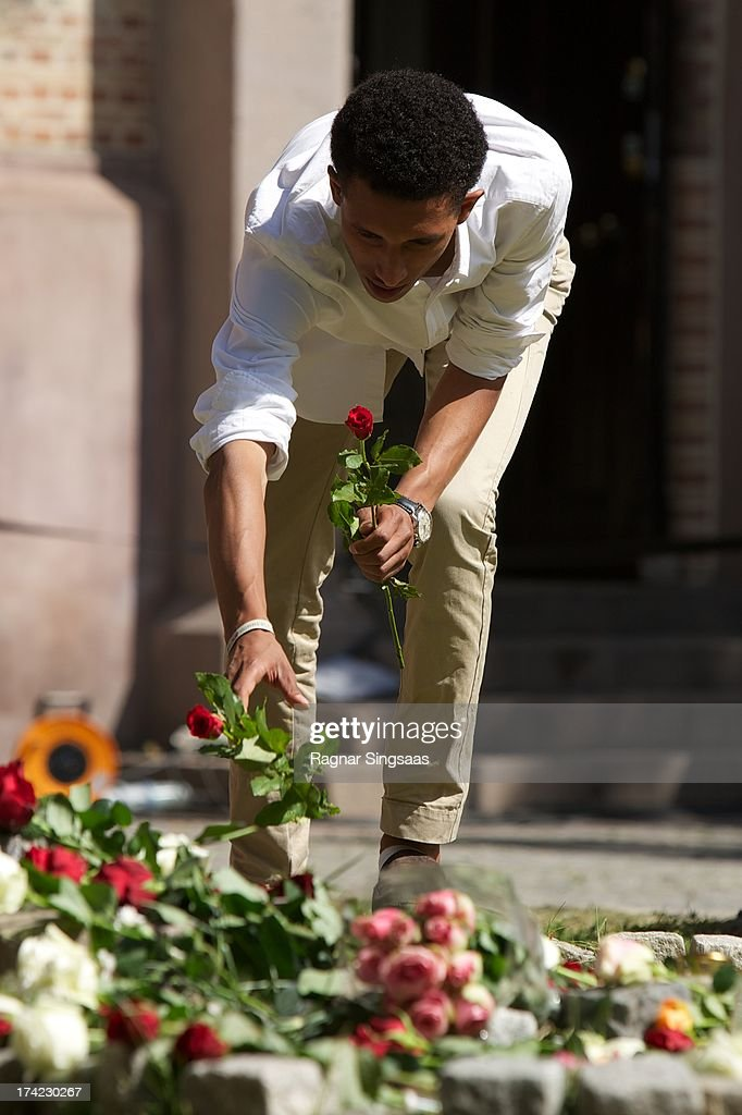 People lay flowers outside Oslo Cathedral in memory of the victims of the 2011 terrorist attacks on July 22, 2013 in Oslo, Norway.