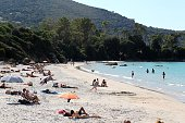 People lay on the Mar e Sole Beach in Pietrosella on September 27 2014 by a sunny afternoon on the French Mediterranean island of Corsica AFP PHOTO /...