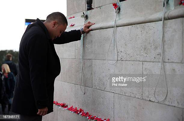 People lay poppies around the Cenotaph following the ANZAC Day dawn service at the Auckland War Memorial Museum on April 25 2013 in Auckland New...