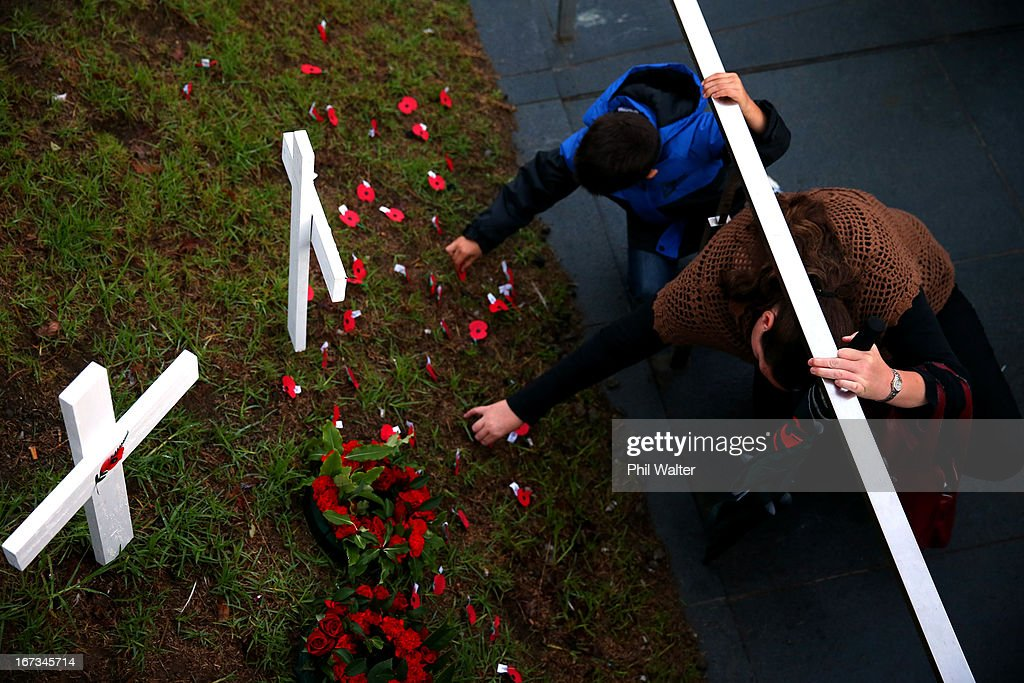 People lay poppies around the Cenotaph following the ANZAC Day dawn service at the Auckland War Memorial Museum on April 25, 2013 in Auckland, New Zealand. Veterans, dignitaries and members of the public today marked the 98th anniversary of ANZAC (Australia New Zealand Army Corps) Day, April 25, 1915 when allied New Zealand and Australian First World War forces landed on the Gallipoli Peninsula. Commemoration events are held across both countries in remembrance of those who fought and died in all wars.