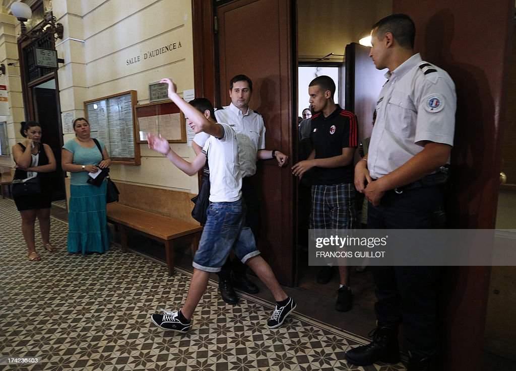 People leave a courtroom at Versailles' Courthouse, near Paris, on July 22, 2013 after the trial of three men for having thrown projectiles on Policemen during unrest in the suburban city of Trappes on July 19 evening. The unrest came after police officers carried out an identity check on a full-face veiled woman and her husband. The woman's husband tried to strangle one of the officers during the check according to Versailles' prosecutor.