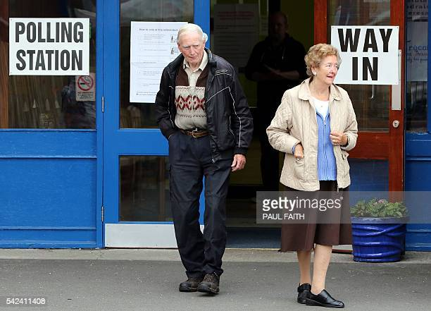 People leave a polling station in Belfast Northern Ireland on June 23 as the United Kingdom holds a referendum to vote on whether to remain in or to...