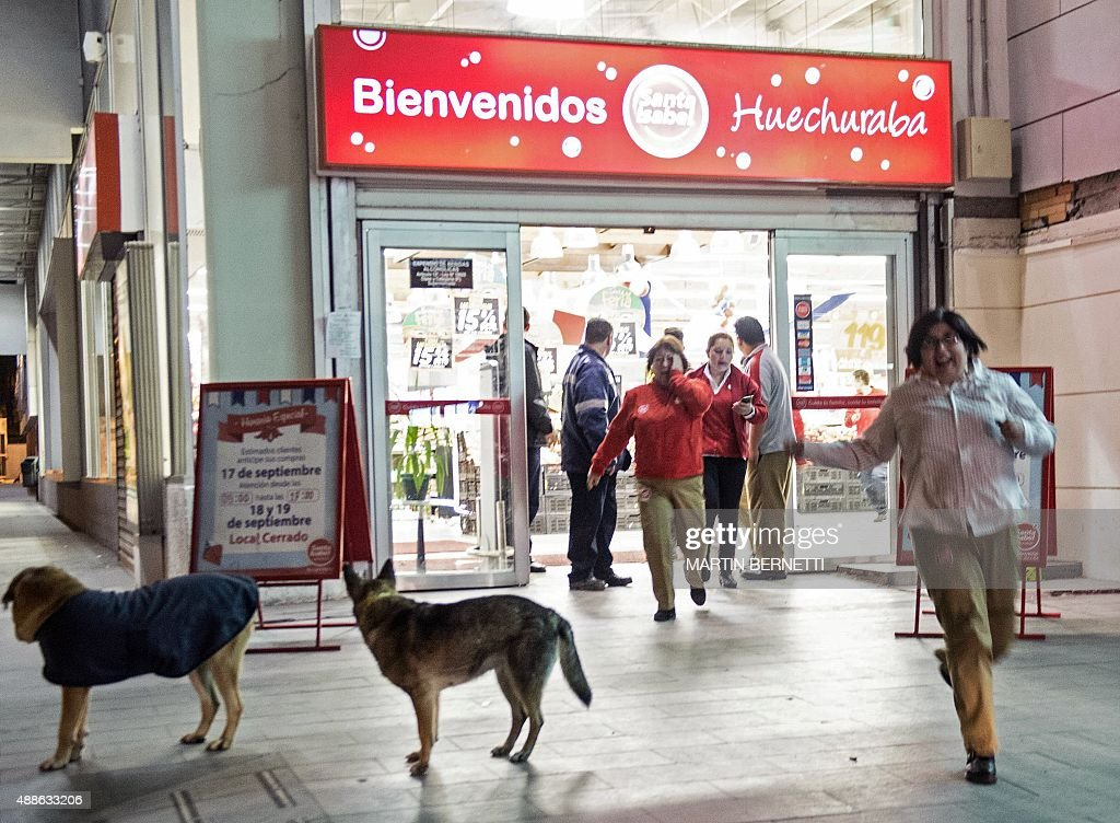 People leave a supermarket during a strong quake in Santiago on September 16 2015 A strong 72magnitude earthquake struck the center of Chile on...