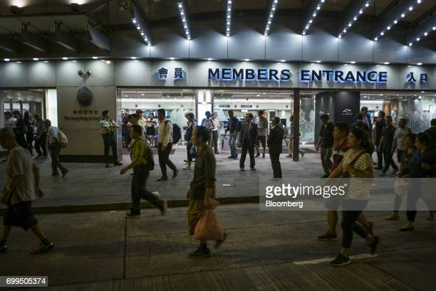 People leave after a race at the Hong Kong Jockey Club's Happy Valley racecourse in Hong Kong China on Wednesday June 14 2017 One of the city's...