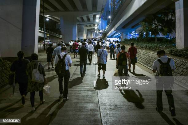 People leave after an evening of racing at the Hong Kong Jockey Club's Happy Valley racecourse in Hong Kong China on Wednesday June 14 2017 One of...