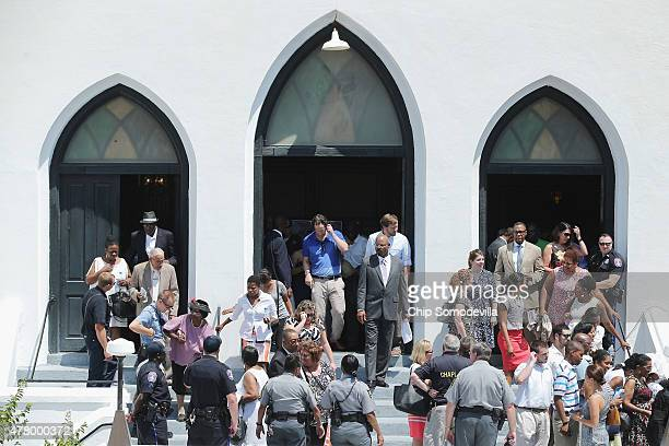 People leave after attending the Sunday morning service at the historic Emanuel African Methodist Church four days after nine of its members were...