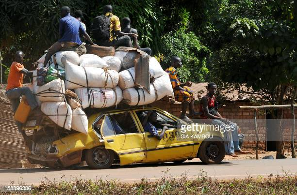 People leave Damara the last strategic town between the rebels from the SELEKA coalition and the country's capital Bangui on January 2 as the...