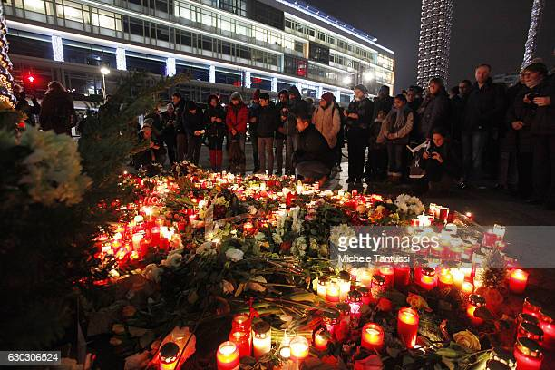 People leave flowers and candles at the area after a lorry truck ploughed through a Christmas market on December 20 2016 in Berlin Germany So far 12...