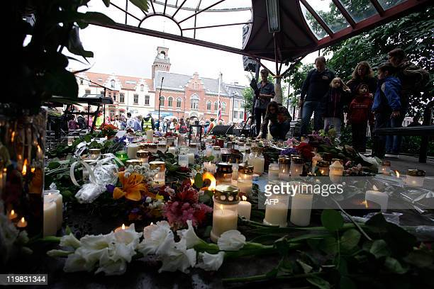 People leave flowers and light candles in Kristiansand a town in southern Norway on July 25 2011 in honour of the victims of the July 22 bomb attack...