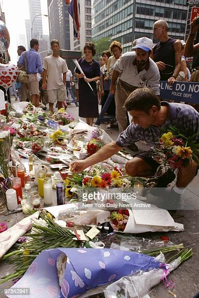 People leave flowers outside the British Embassy on Third Ave in memory of Princess Diana killed in a Paris car crash