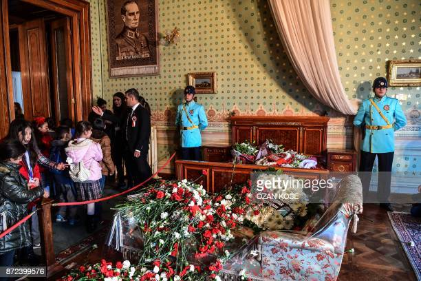 TOPSHOT People leave flowers where Mustafa Kemal Ataturk founder of modern Turkey died as they pay their respects at 0905am the time of his death at...