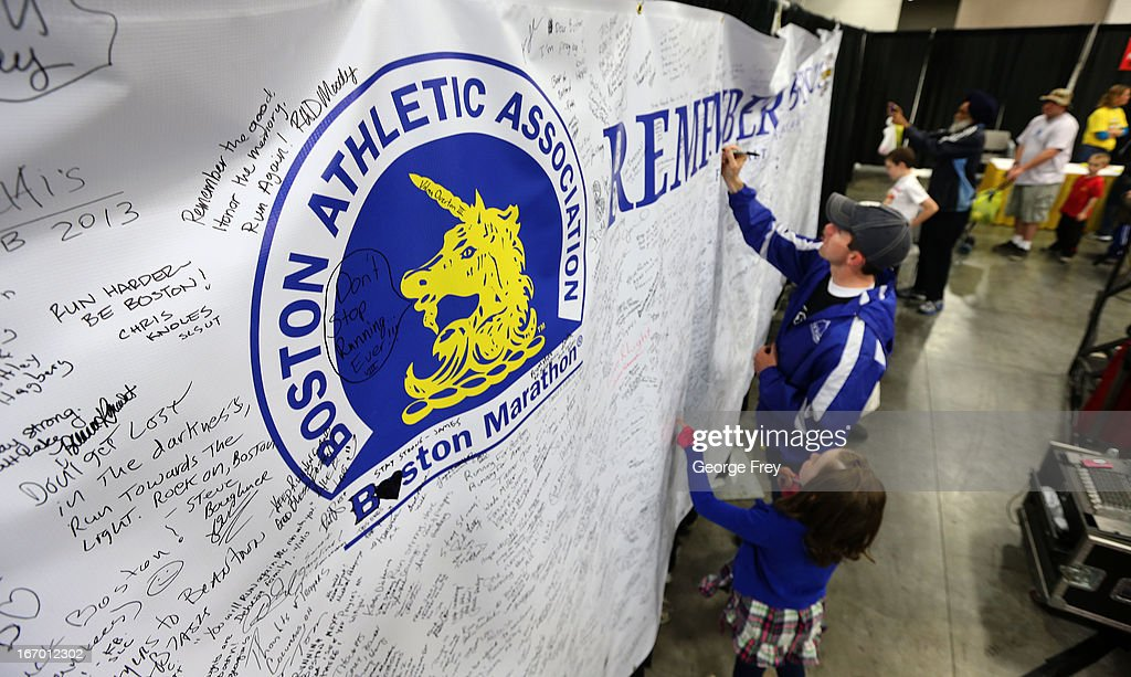 People leave messages on a large banner for the victims of the Boston Marathon bombing, at the race headquarters of the Salt Lake City Marathon, April, 19, 2013 in Salt Lake City, Utah. The Salt Lake City Marathon is going to be run tomorrow, April 20, 2013 and will be the first major marathon in the U.S. since the Boston Marathon Bombing. Police officials have said security has been dramatically increased since the Boston bombing and is at some the highest levels since the city hosted the 2002 Olympics.