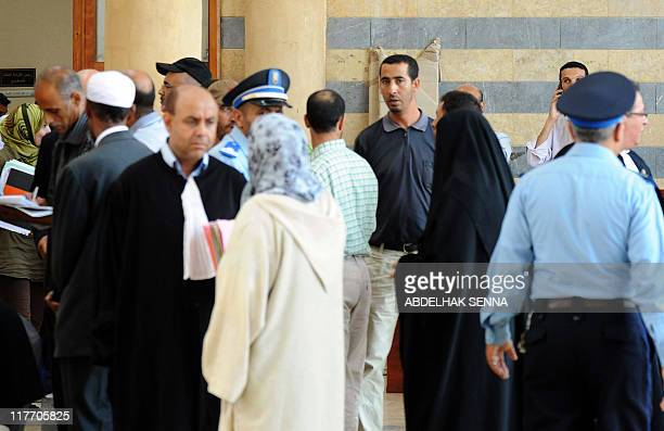 People leave on June 30 2011 after attending the opening of the trial of eight of their relatives accused of the Marrakesh cafe bombing late April 28...
