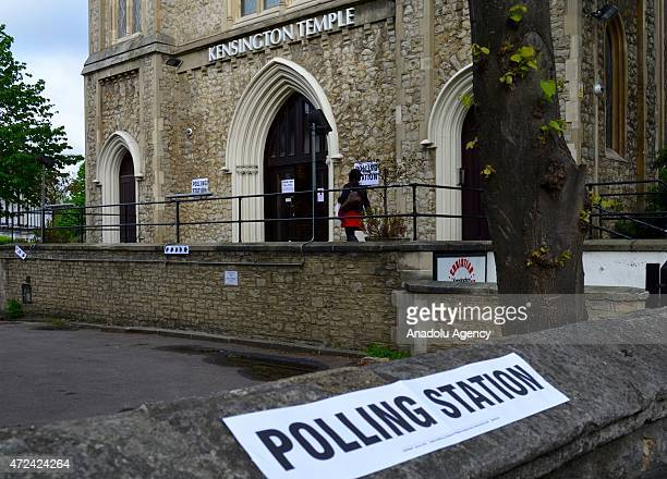 People leave polling stations after casting their ballots in the UK General Election in London United Kingdom on May 7 2015