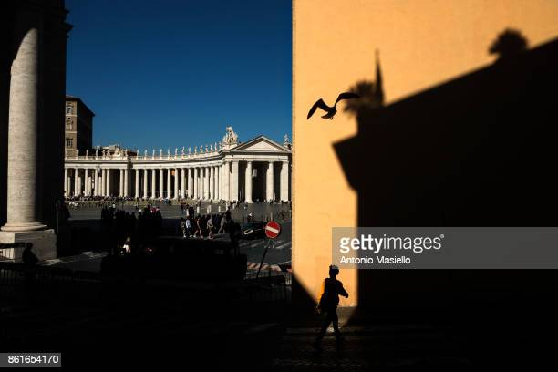 People leave St Peter's Square after a canonization mass for 35 new saints celebrated by Pope Francis at the Vatican city on October 15 2017 in Rome...