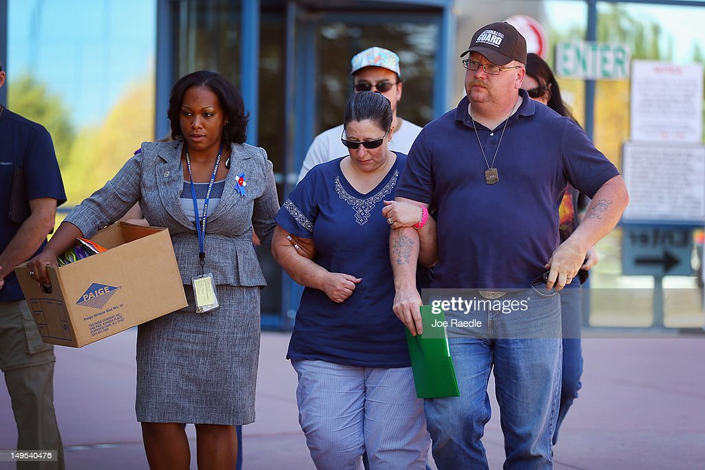 People leave the Arapahoe County Courthouse where the arraignment hearing for suspect James Holmes was held on July 30, 2012 in Centennial, Colorado. James Holmes, 24, who is accused of killing 12 people and injuring 58 in a shooting spree July 20, during a screening of 'The Dark Knight Rises.' in Aurora, Colorado was charged with 24 counts of first-degree murder and 116 counts of attempted murder.