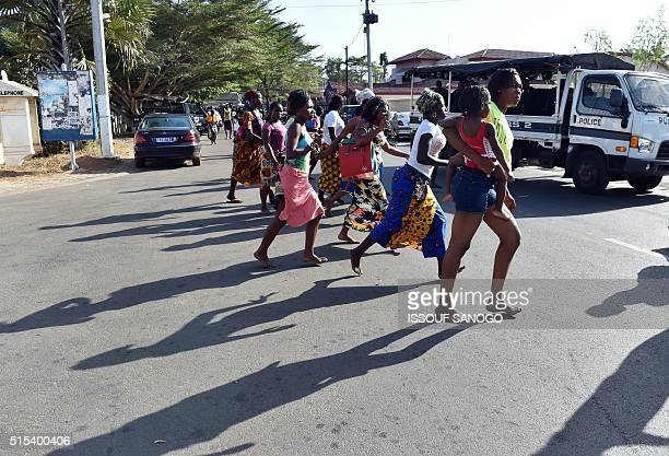 people leave the beach after heavily armed gunmen opened fire on March 13 2016 at a hotel in the Ivory Coast beach resort of GrandBassam At least...