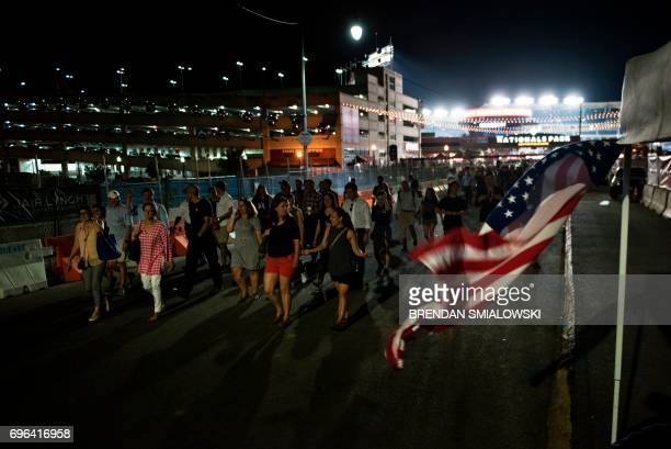 People leave the Congressional Baseball Game between Democrats and Republicans at Nationals Stadium June 15 2017 in Washington DC This year's...