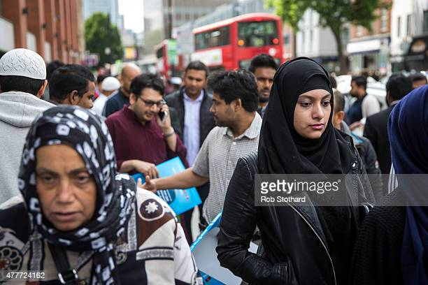 People leave the East London Mosque after attending the first Friday prayers of the Islamic holy month of Ramadan on June 19 2015 in London England...