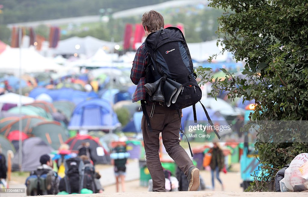 People leave the Glastonbury Festival of Contemporary Performing Arts site at Worthy Farm, Pilton on July 1, 2013 near Glastonbury, England. Gates opened on Wednesday at the Somerset diary farm that plays host to one of the largest music festivals in the world and this year featured headline acts Artic Monkeys, Mumford and Sons and the Rolling Stones. Tickets to the event which is now in its 43rd year sold out in minutes and that was before any of the headline acts had been confirmed. The festival, which started in 1970 when several hundred hippies paid 1 GBP to watch Marc Bolan, now attracts more than 175,000 people over five days.