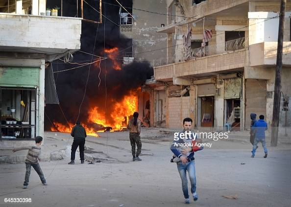People leave the impact site after Assad Regime's airstrike over civilians in residential areas of Ariha town of Idlib Syria on February 25 2017 Many...