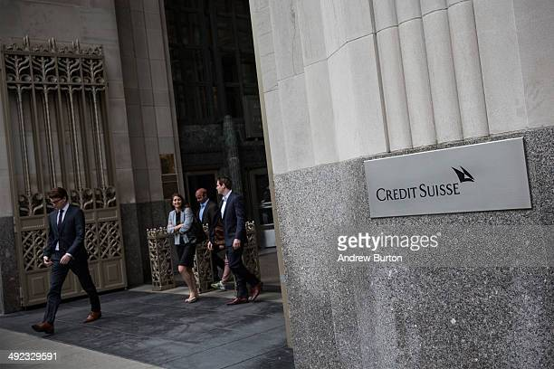 People leave the New York offices of Credit Suisse on May 19 2014 in New York City Credit Suisse is expected to plead guilty to one count of criminal...