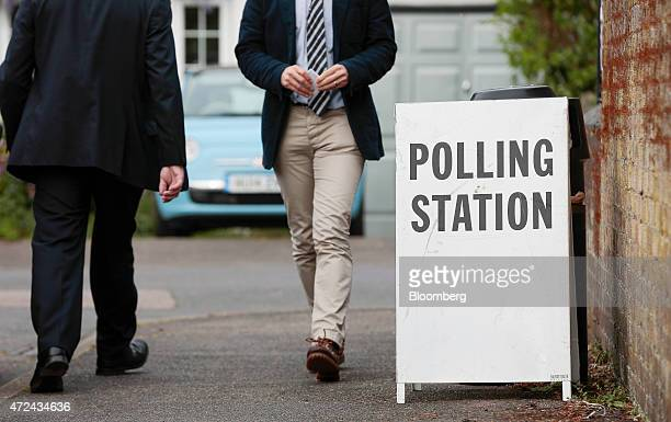 People leave the polling station at Shalford Infant School after casting their vote in the 2015 general election in Shalford UK on Thursday May 7...