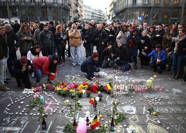 People leave tributes at the Place de la Bourse following today's attacks on March 22 2016 in Brussels Belgium At least 31 people are thought to have...