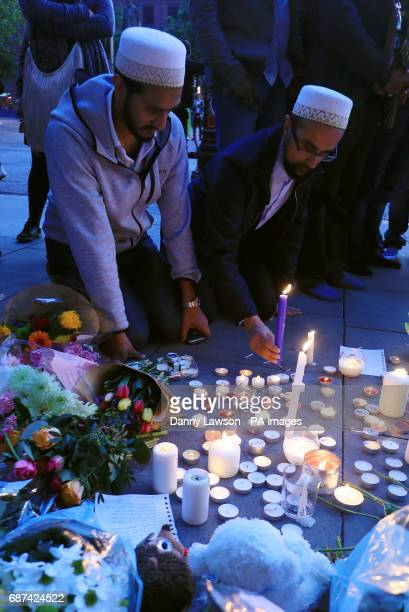 People leave tributes in Albert Square Manchester after a 23yearold man was arrested in connection with the Manchester concert bomb attack