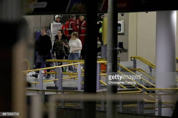 People leave Victoria Station adjacent to Manchester Arena on May 23 2017 in Manchester England An explosion occurred at Manchester Arena as concert...